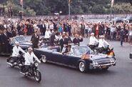 1962-jfkonparade-braving-a-open-lincoln.jpgmid