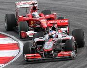 Jenson Button and Fernando Alonso 2010 Malaysia