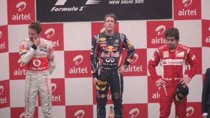 Podium winners of 2011 Indian Grand Prix