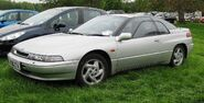 1200px-Subaru SVX in parkland in the British West Midlands first registered February 1997 3317cc