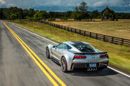 2017-Chevrolet-Corvette-Grand-Sport-rear-three-quarter-in-motion-04