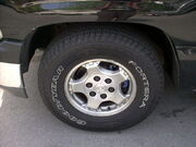 A Goodyear Fortera Silent Armor Tire with raised white letters