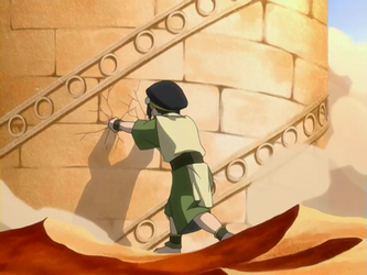 File:Toph slowing down the library.png