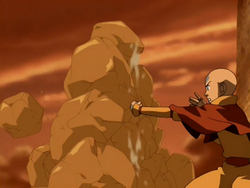 Aang creates earth wall