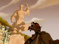 Kahchi destroys Chin's statue