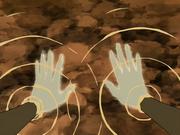 Katara curando sus manos