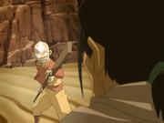 Aang stellt Sandbändiger zur Rede