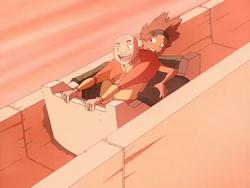 Young Bumi and Aang sliding