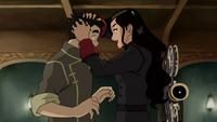 Asami ruffles Bolin's hair