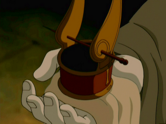 File:Iroh holding out the headpiece.png