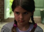 Emma Lockhart as Rachel Dawes (Age 8)