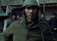 Tom Wu as Bhutanese Prison Guard 1