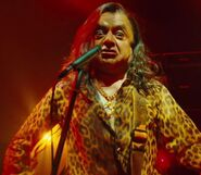 Deep Roy as Oompa Loompas (Rock Band Member 3)