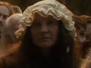 Kathryn Briggs Hobbs as Laketowner (DOS)