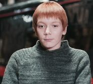 James Phelps as Fred Weasley (PS)