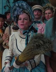 Melissa Exelberth as Quadling Woman with Broom