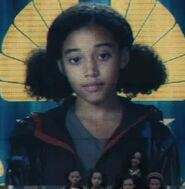 Amandla Stenberg as Rue (Archive Footage) (CF)
