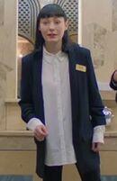 Terenia Edwards as Harrods Worker - Siobhan
