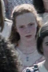 Emily MacMillan as District 12 Reaping Girl