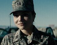 Christina Wren as Major Carrie Farris (MOS)