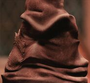Leslie Phillips as The Sorting Hat (Voice) (PS)