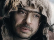 Ryan Gage as Alfrid (Woman's Dress)