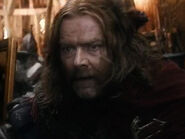 Mark Mitchinson as Braga (BOTFA)