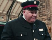 Harry Taylor as Station Guard (PS)