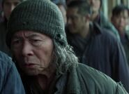 Vincent Wong as Old Asian Prisoner