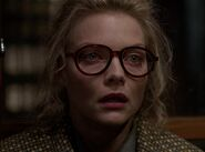 Michelle Pfeiffer as Selina (Glasses)