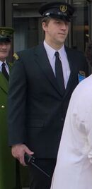 Tom Greaves as Harrods Security
