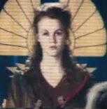 Mackenzie Lintz as Tribute Girl District 8 (Archive Footage) (CF)