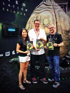 Isolation cast holding comics at SDCC