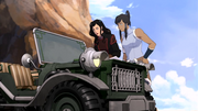 Asami and Korra look at a map
