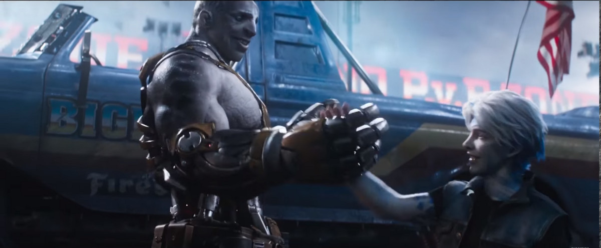 A screenshot of Aech and Parzival shaking hands, from the latest trailer. Aech is an orc, and towers over Parzival.
