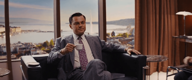 wolf of wall street leonardo dicaprio in office drinking coffee