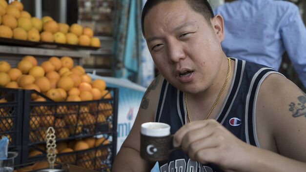 huangs-world-eddie-huang in street-side cafe with turkish coffee