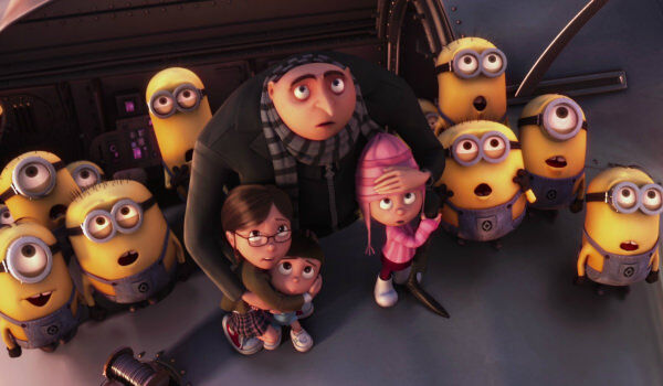 Despicable Me Gru with children and surrounded by gaping minions
