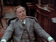 John Watson (Hardwicke) in armchair at 221B