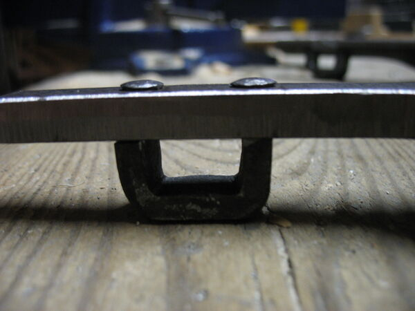 Riveting pi-brackets to field frame bars - 02