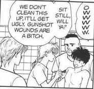 Eiji in pain from the gunshot wound