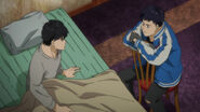 Eiji and Sing meet eachother after Eiji is saved by Sing
