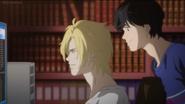 Eiji looks over Ash's shoulder