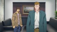 Shunichi and Max glare at the guard