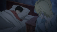 Ash looks over Eiji