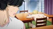Eiji notices Ash sleeping on the table