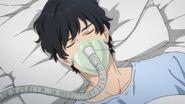Eiji wears a oxygen mask in the hospital