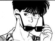 Eiji lowering his sunglasses