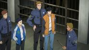 A policeman tells Eiji and Sing all right, you both follow me
