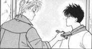 Ash gives Eiji a gun